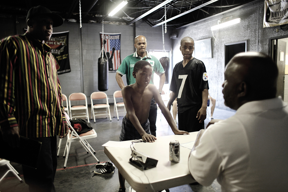 Boxers weigh in before Downtown Boxing Gym's Brawl For It All event on Sunday, May 5, 2013 at the Downtown Boxing Gym in Detroit.