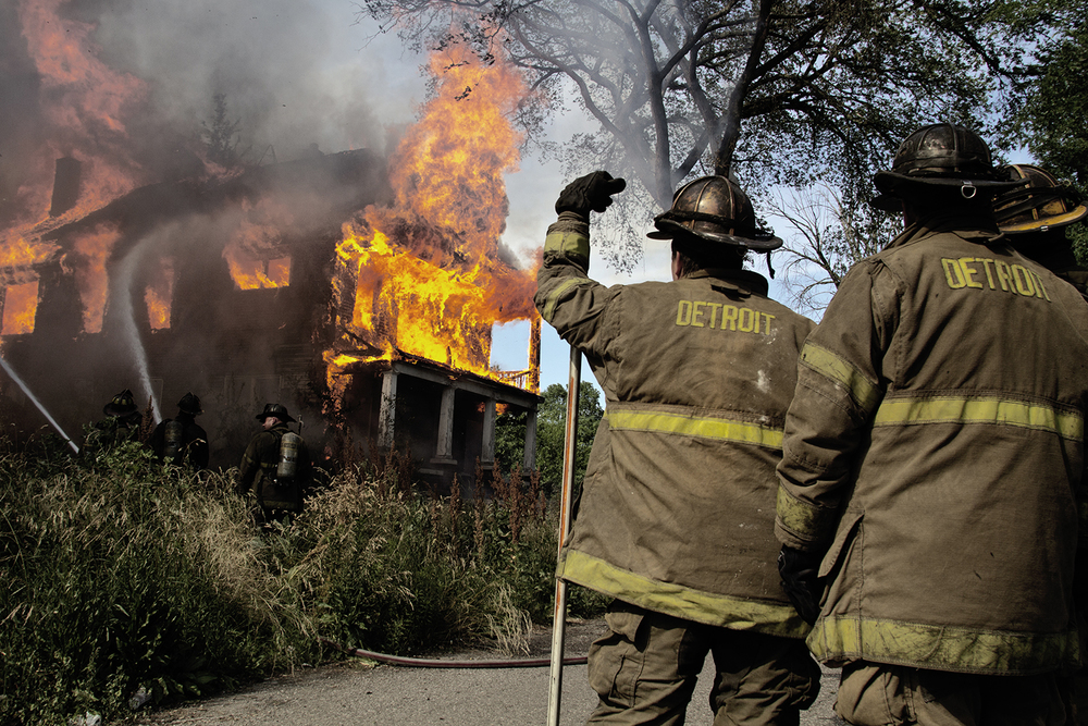 Detroit firefighters contain a blazing abandoned home in the Black Bottom neighborhood on Wednesday, June 13, 2012 in Detroit.