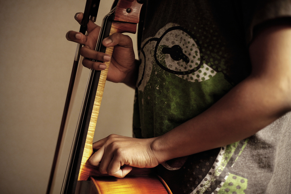 Sterling Elliott, 14, of Newport News, VA, stands with his cello in his hotel room at the Renaissance Marriott hotel on Tuesday, Feb. 18, 2014 in the GM Renaissance Building in Detroit, MI. Elliott practiced in his room to ready himself for the upcoming Sphinx Competition.