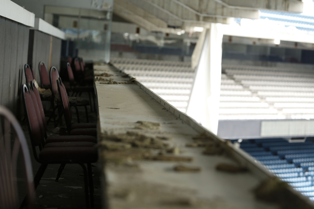 Dust and debris from ceiling panels sit on the table in the former press box at the Pontiac Silverdome on Friday, May 9, 2014 in Pontiac. Tim Galloway for Al Jazeera America