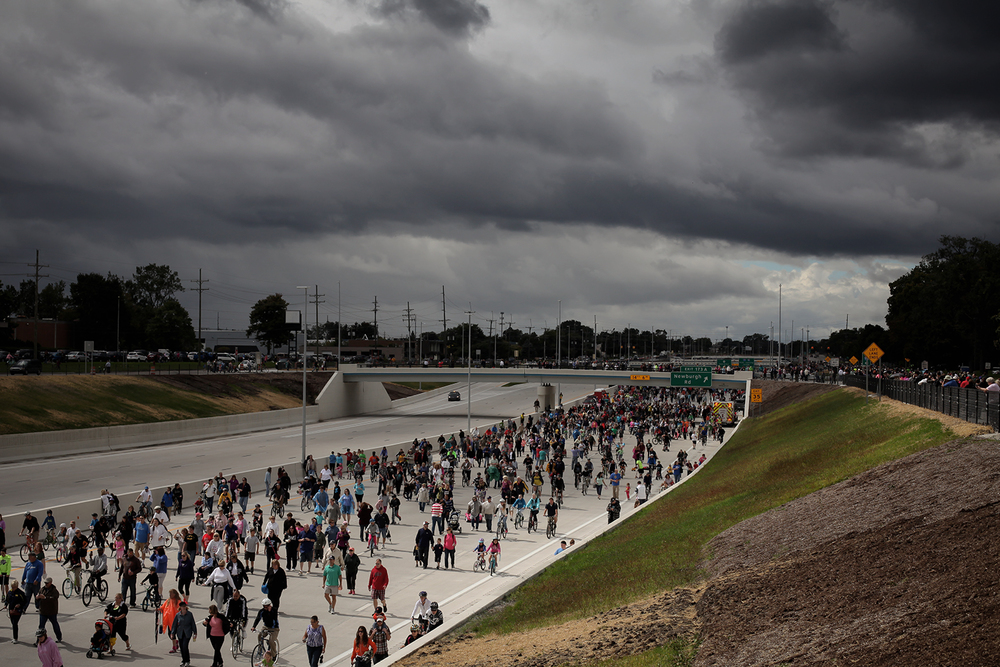 Cyclists, walkers, runners, skateboarders and rollerbladers move down the open freeway at the 96fix Walk on Sunday, Sept. 21, 2014 in Livonia. Tim Galloway/Special to DFP