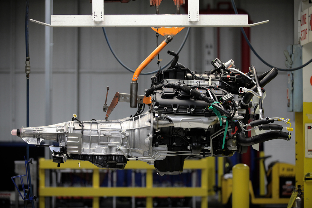 An engine hangs from the assembly line during the media open house on Thursday, Sept. 25, 2014 at the Chrysler Group Warren Truck Assembly plant in Warren. Tim Galloway/Special for DFP