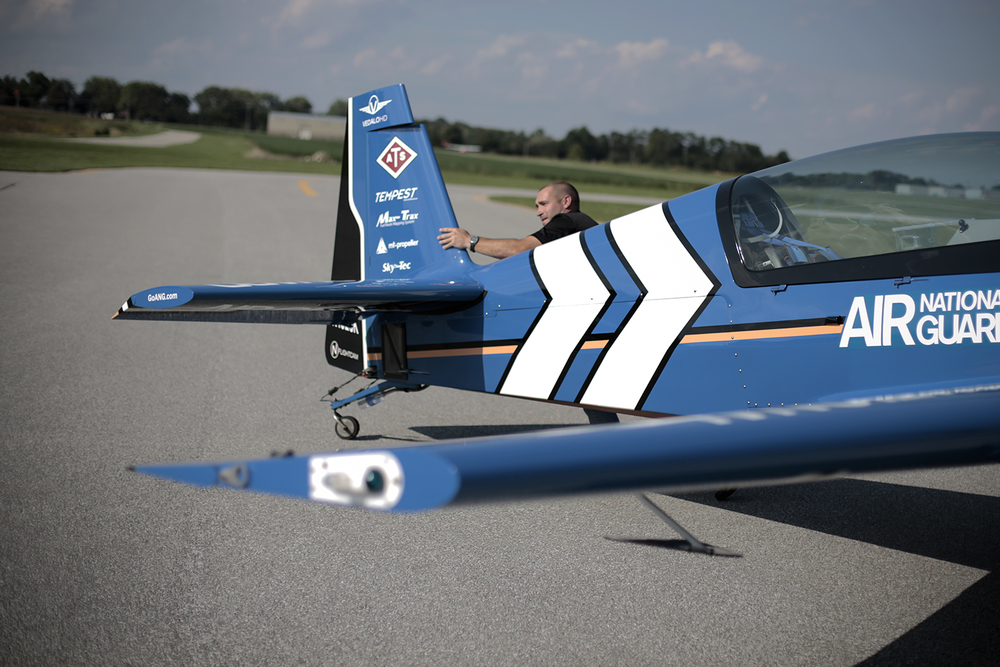 Ben Anderson from Havre de Grace, Maryland pushes the Air National Guard Extra 300L into position on the runway on Wednesday, Sept. 3, 2014 at the Romeo State Airport in Romeo. Tim Galloway/Special for DFP