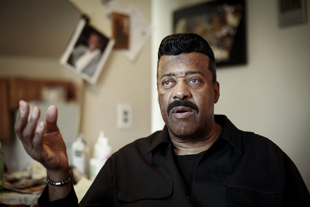 Walter McKinny, 60, from Detroit talks about the first time he decided to get finger waves after being styled on Saturday, May 3, 2014 at Michael Horner's  home in Detroit. Tim Galloway for Al Jazeera America