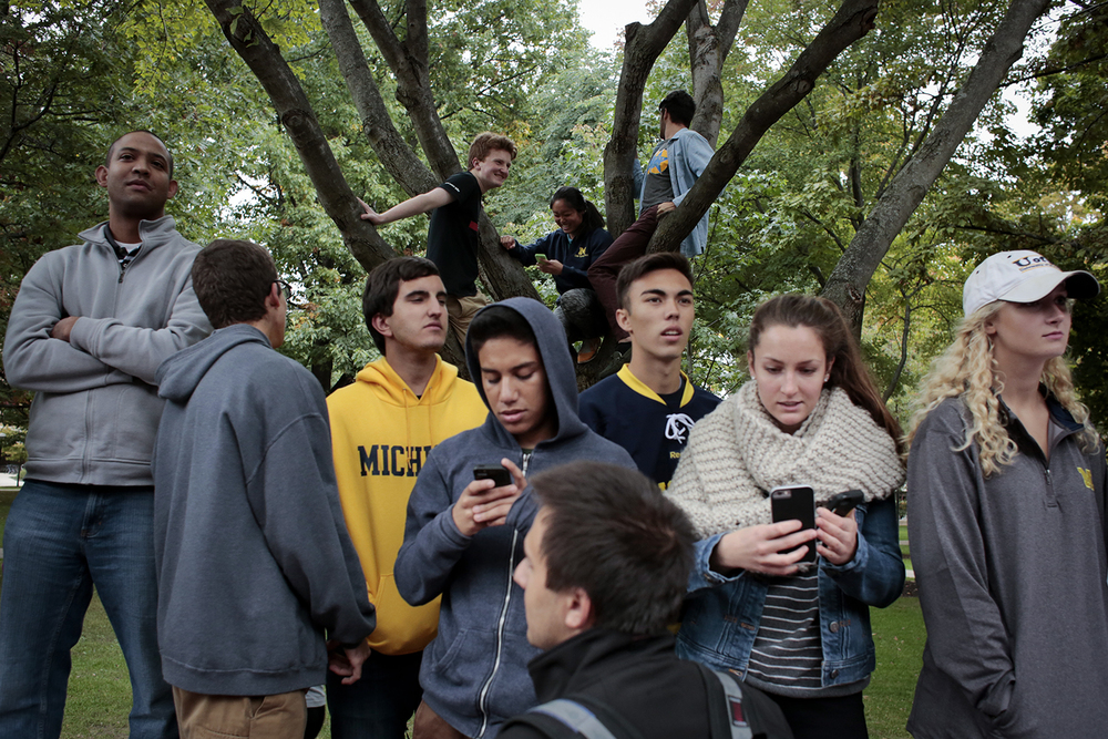 Attendees stand on the edges and climb on the trees along the Diag at the Fire Dave Brandon rally on Tuesday, Sept. 30, 2014 at the University of Michigan in Ann Arbor. Tim Galloway/Special to DFP