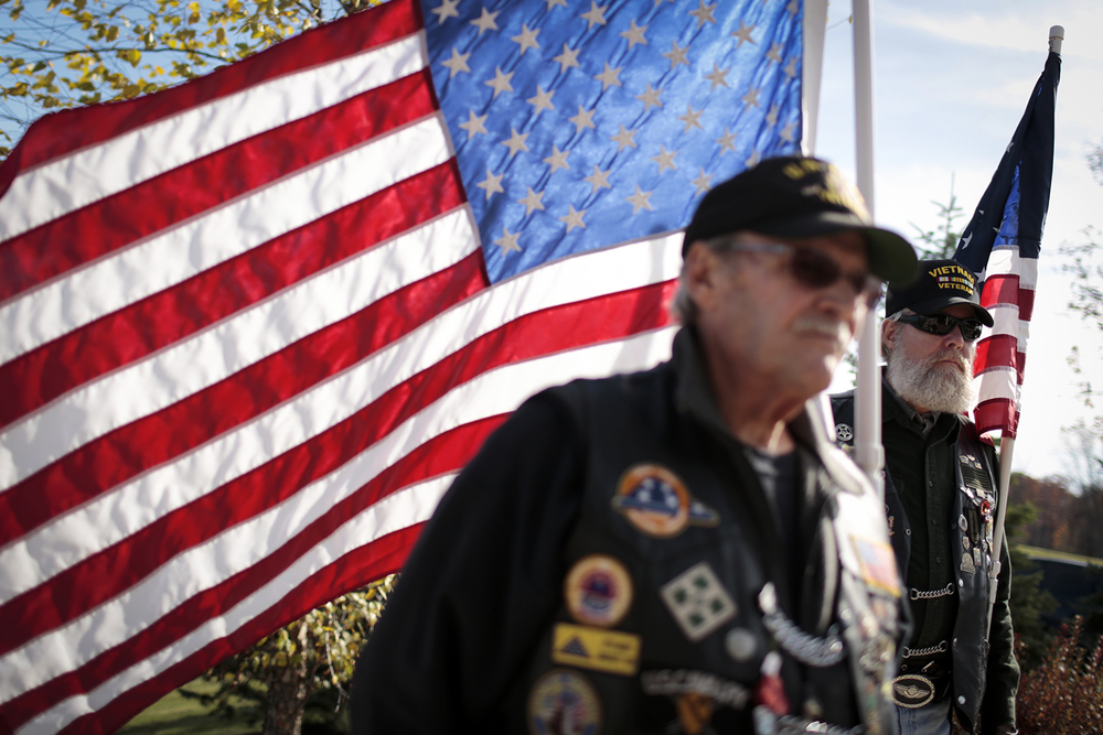 "Gene Raffin, left, and ""Partnr"", right, both from Rochester Hills listen to the memorial service for Thomas Railling on Thursday, Oct. 23, 2014 at the Great Lakes National Cemetery in Holly. Railling died at 22 years of age during the Korean War as a POW. Tim Galloway/Special to the Free Press"