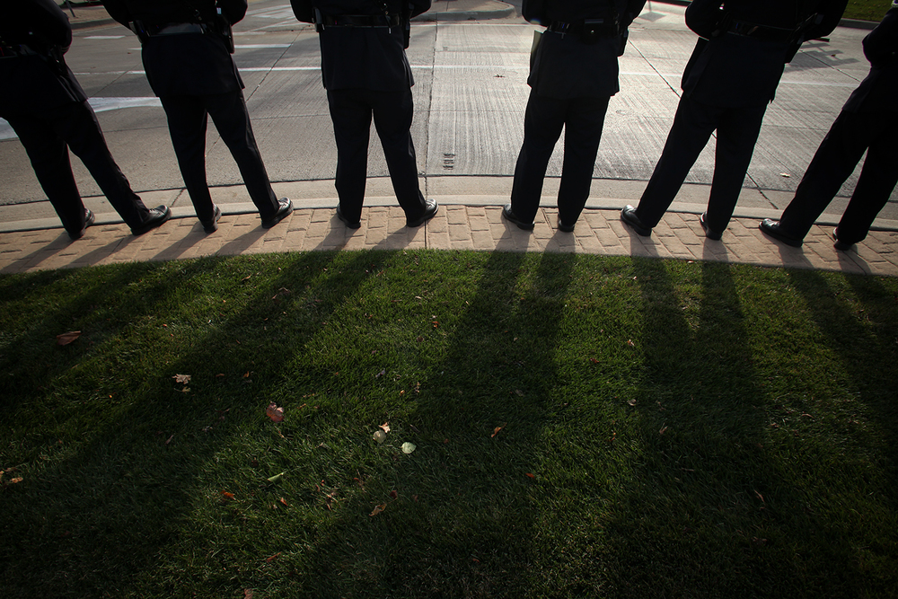Sterling Heights Police Honor Guard stand at the ready along the funeral procession route of longtime Sterling Heights Mayor Richard Notte on Monday, Nov. 3, 2014 near Dodge Park in Sterling Heights. Tim Galloway/Special to DFP