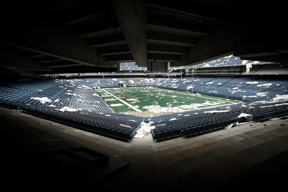 Pieces of the roof litter the stands and playing field at the Pontiac Silverdome on Friday, May 9, 2014 in Pontiac.