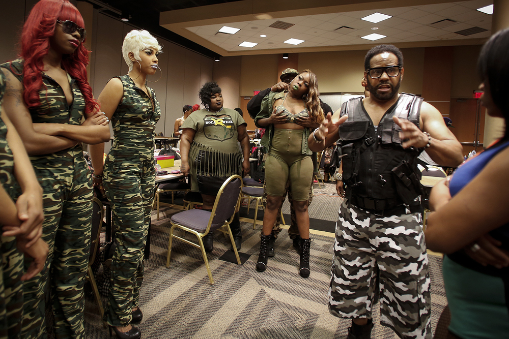 Ali Du'Shua, right, reviews his upcoming act for Hair Wars with his models and stylists on Sunday, May 4, 2014 at the Adoba Hotel in Dearborn.