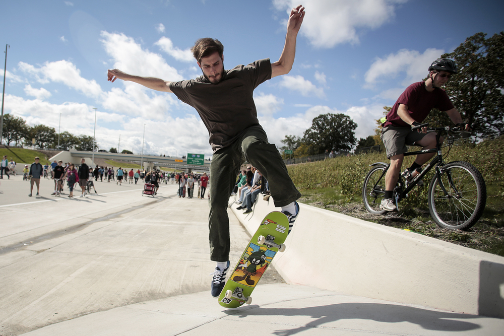Michael Lance from Plymouth took the opportunity to skateboard on the embankment of I96 during the 96fix Walk on Sunday, Sept. 21, 2014 in Livonia.