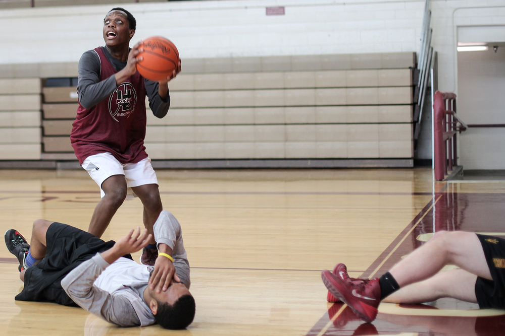 Cassius Winston, center, 16, Junior, from Detroit attempts a shot after recovering the ball. Winston and his team practiced on the afternoon of Wednesday, Jan. 14, 2015 at the U of D Jesuit High School in Detroit. Tim Galloway/Special to DFP
