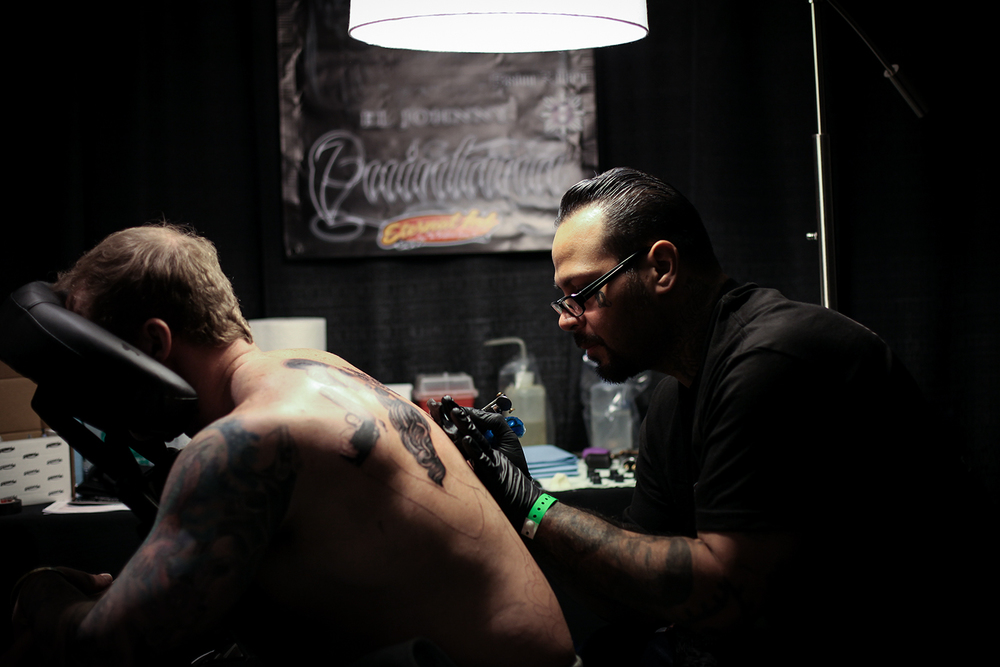 Jason McCarty from Washington D.C., left, has his back tattooed by Johnny Quintana from Arcadia, CA during the Motor City Tattoo Expo on Saturday, March 7, 2015 at the GM Renaissance Center in Detroit. Tim Galloway/Special to DFP