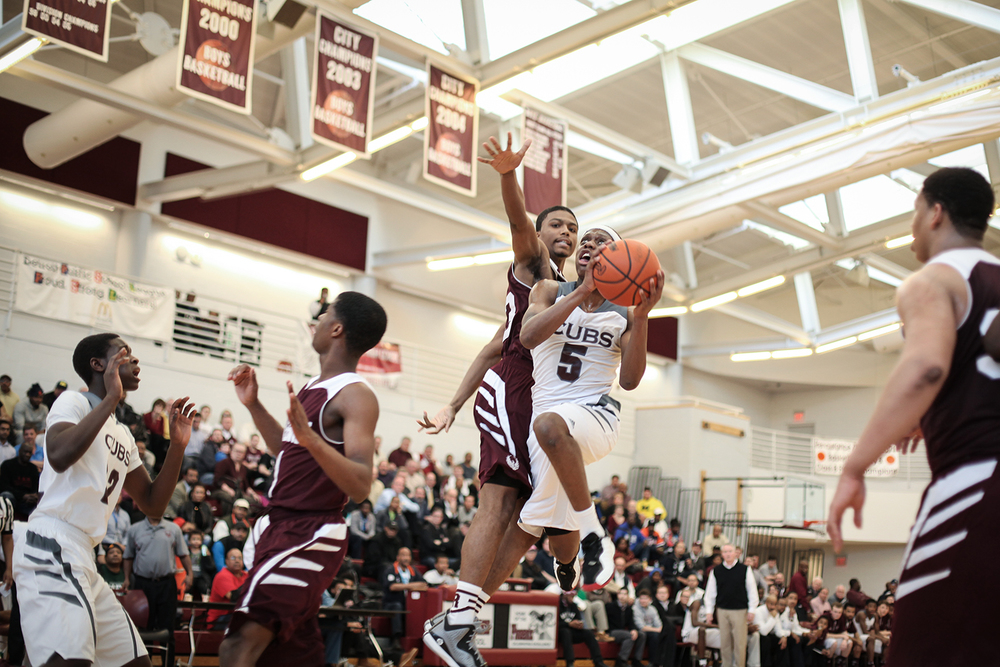 Renaissance's Daelyn Davis (33/F) tries to block U of D's Cassius Winston (5/G) as he goes for a shot during the Detroit Renaissance vs, U of D Jesuit district semi-final boys' basketball game on Wednesday, March 11, 2015 at Detroit Renaissance High School in Detroit. U of D Jesuit beat Detroit Renaissance 66 to 53. Tim Galloway/Special for DFP
