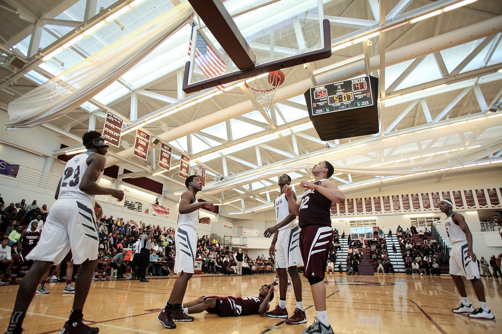 Darryl Smith (15/G), center, looks at the net from the floor as he waits for the shot to go in the basket during the Detroit Renaissance vs, U of D Jesuit district semi-final boys' basketball game on Wednesday, March 11, 2015 at Detroit Renaissance High School in Detroit. U of D Jesuit beat Detroit Renaissance 66 to 53. Tim Galloway/Special for DFP