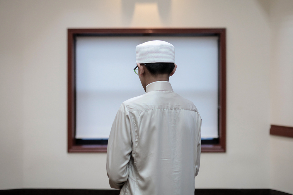 Jibril Syed, 13, from Auburn Hills prepares for prayer before the call to prayer on Thursday, Apr. 2, 2014 at the Tawheed Center in Farmington Hills. Syed plans to travel the United States to do the Muslim call to prayer in each of the 50 states over the next month. Tim Galloway/Special to DFP