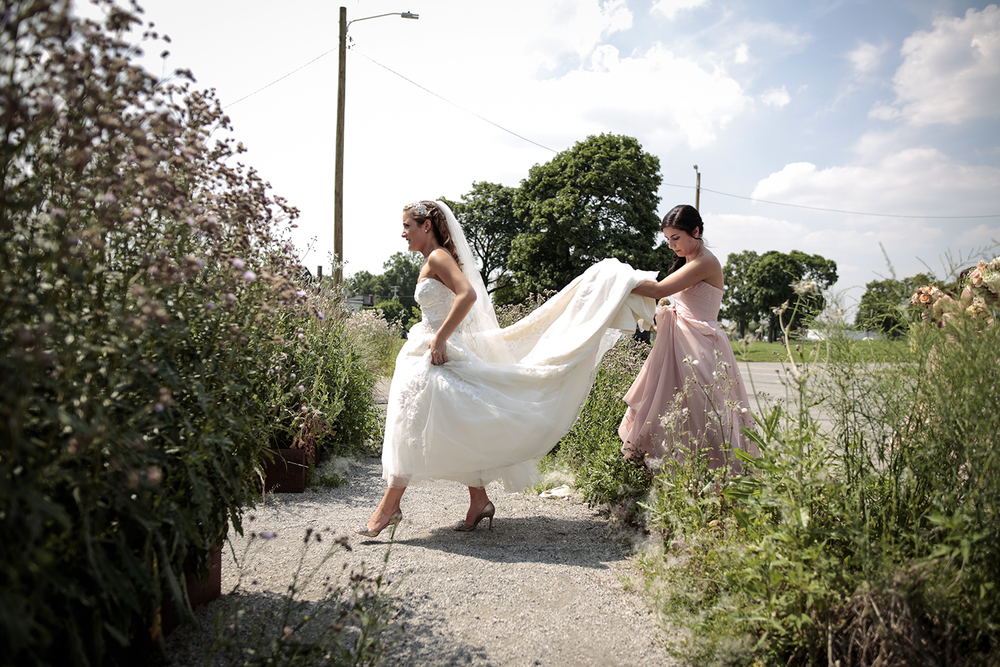 Marni Weinstein from Chicago, IL, right, assists Lil McDowell from Farmington Hills with her dress in front of Michigan Central Station on Saturday, July 11, 2015 at Roosevelt Park in Detroit. Tim Galloway/Special for DFP