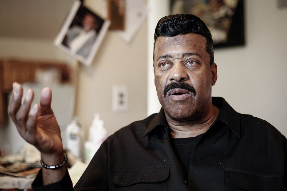 After being styled, Walter McKinny, 60, from Detroit talks about the first time he decided to get finger waves on Saturday, May 3, 2014 at Michael Horner's home in Detroit.