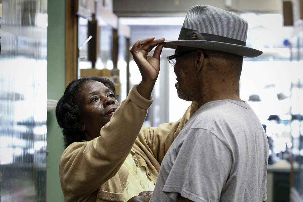 Pam McLean, left, helps Alfred Campbell, of River Rouge, find a hat on Friday, June 15, 2012 at Henry the Hatter in Detroit.