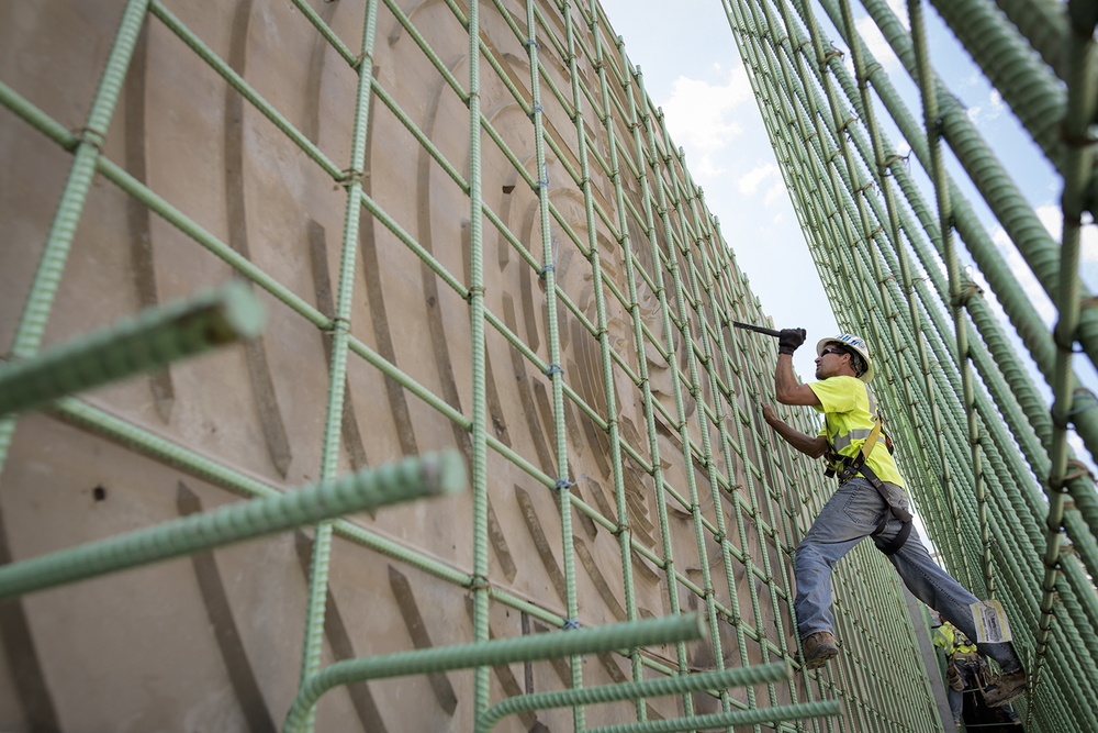 Detroit, MI - Tuesday, August 11, 2015: Rich Robb from Macomb Township, MI removes and repairs construction joints before concrete is poured for the M-1 Rail on Tuesday, August 11, 2015 in Detroit. The M-1 Rail will run 3.3 miles along Woodward Avenue in Detroit. It is the first public transit project to bring together both public and private funding for its construction.