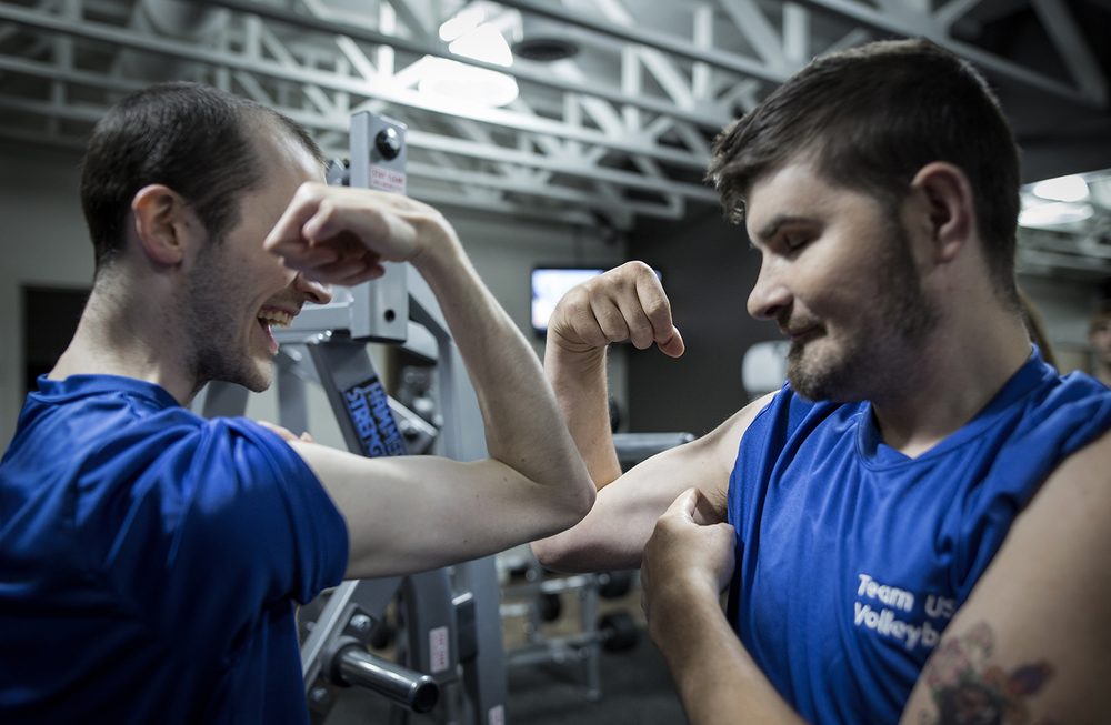 Grand Blanc, MI - Thursday, June 25, 2015: Brett Rife, left, from Flint, MI and Joe Gross from Montrose, MI show off and compare their muscles during their training session at Anytime Fitness in Grand Blanc, MI. The Michigan Special Olympics Volleyball Team has been preparing for the 2015 Special Olympics Summer Games in Los Angeles, CA beginning July 25. (Tim Galloway for ESPN)