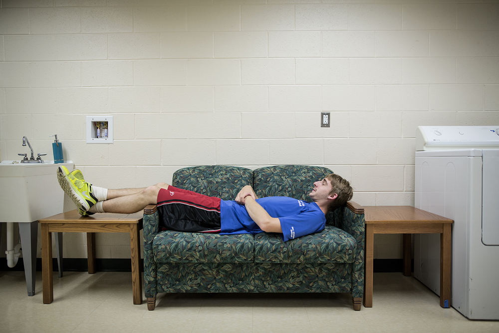 Flint, MI - Thursday, June 25, 2015: Athlete Drew Callahan from Clio, MI rests after dinner on a nearby couch at the Elmer A. Knopf Learning Center in Flint, MI. The Michigan Special Olympics Volleyball Team has been preparing for the 2015 Special Olympics Summer Games in Los Angeles, CA beginning July 25. (Tim Galloway for ESPN)