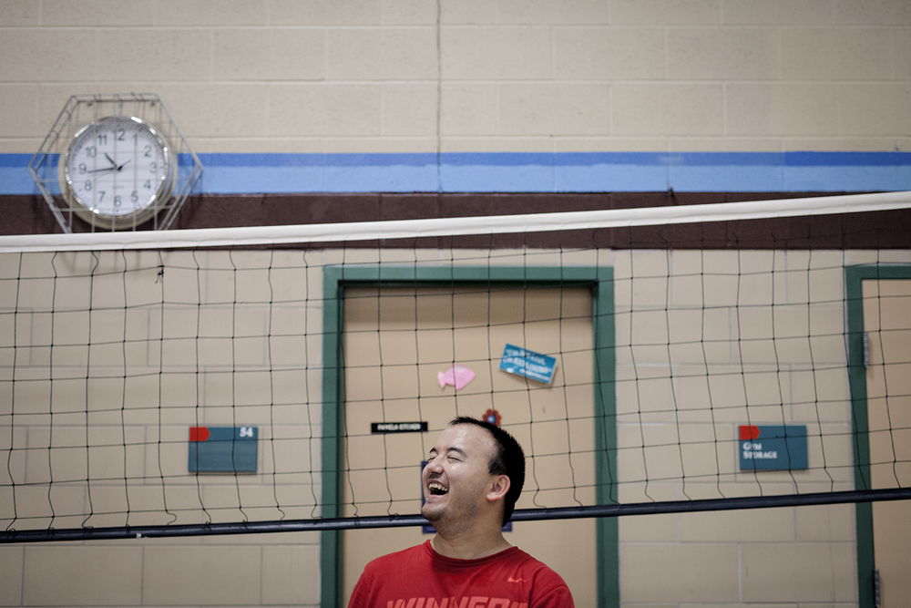 Flint, MI - Thursday, June 25, 2015: Stephen Miller from Flushing, MI laughs as he waits to participate in training drills during practice at the Elmer A. Knopf Learning Center in Flint, MI. The Michigan Special Olympics Volleyball Team has been preparing for the 2015 Special Olympics Summer Games in Los Angeles, CA beginning July 25. (Tim Galloway for ESPN)
