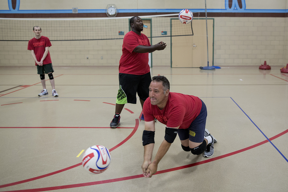 Flint, MI - Thursday, June 25, 2015: From left: Brett Rife from Flint, MI looks on as Michael Robinson from Grand Blanc, MI and Dan Sebedra from Flint, MI participate in drills during practice at the Elmer A. Knopf Learning Center in Flint, MI. The Michigan Special Olympics Volleyball Team has been preparing for the 2015 Special Olympics Summer Games in Los Angeles, CA beginning July 25. (Tim Galloway for ESPN)