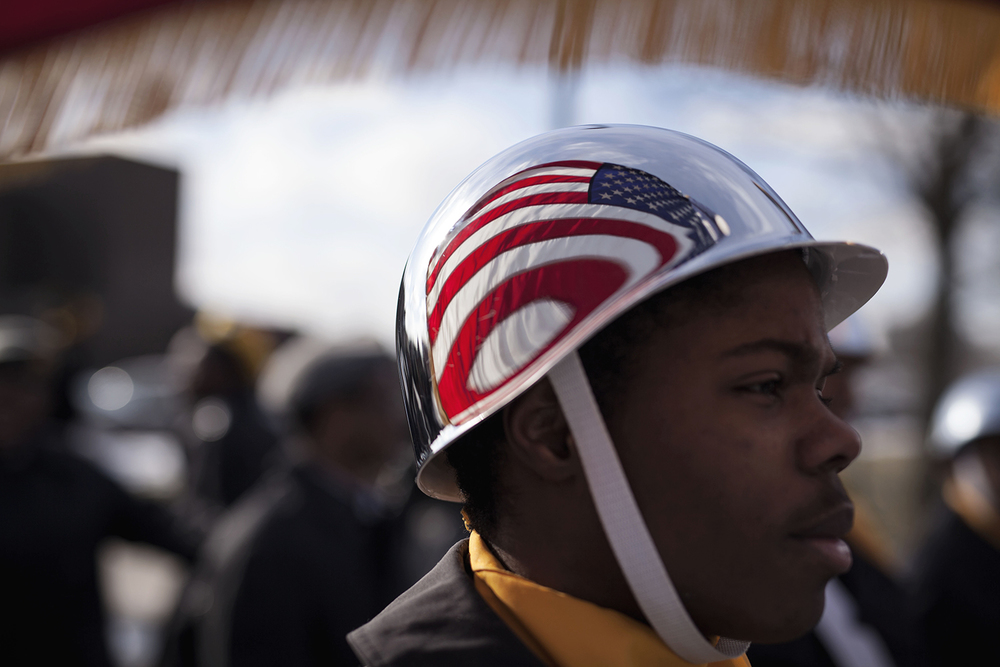Martin Luther King Jr. High School JROTC cadet Artez Surles, 17, holds the American Flag and waits for orders to march at the 7th Annual Martin Luther King Jr. Legacy March at Martin Luther King Jr. High School on Monday, Jan. 18, 2016 in Detroit. Surles has been a member of the Color Guard since 9th Grade and was proud to be a part of the march in spite of the cold. Tim Galloway/Special for DetNews