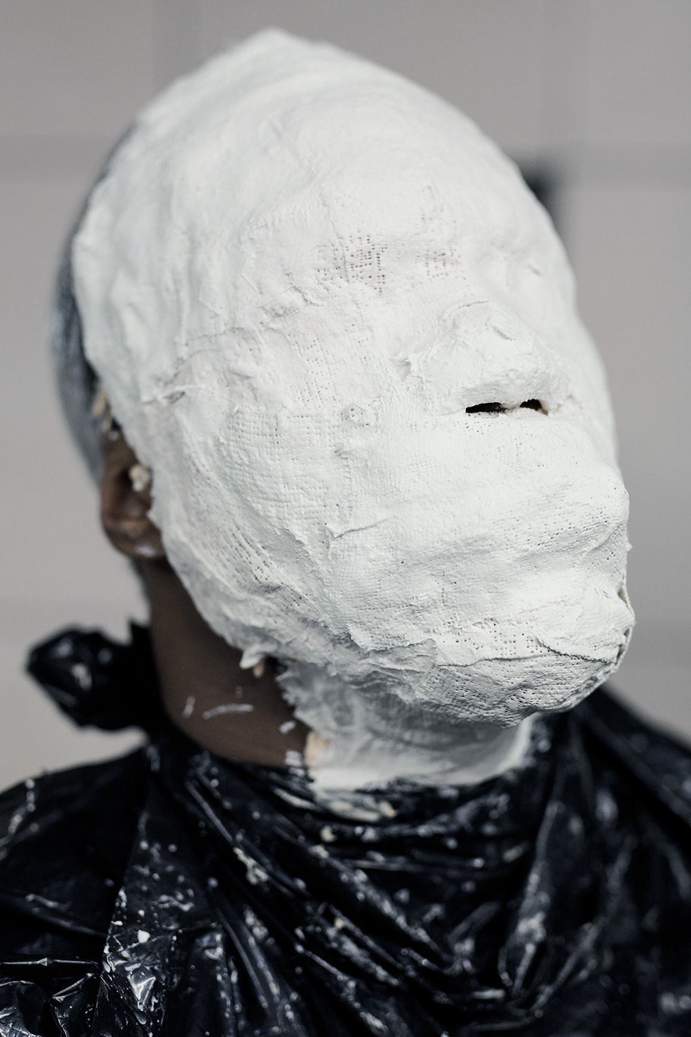 Clarence Houston from Detroit sits patiently as he waits for plaster strips to be applied to his face to make a mold during the face casting demonstration on Saturday, Jan. 30, 2016 at the Red Bull House of Art in Detroit. Tim Galloway/Special to DFP