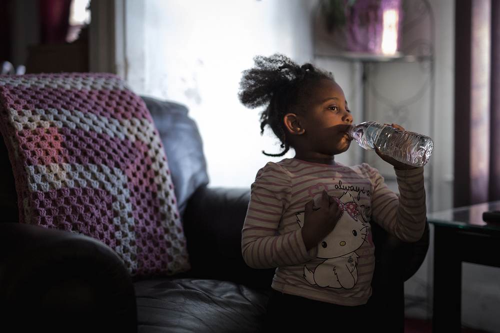 Flint, MI - Feb. 11, 2016:  Jayla Keith, 4, drinks from a water bottle in the living room of her home on Thursday, Feb. 11, 2016 in Flint, MI.