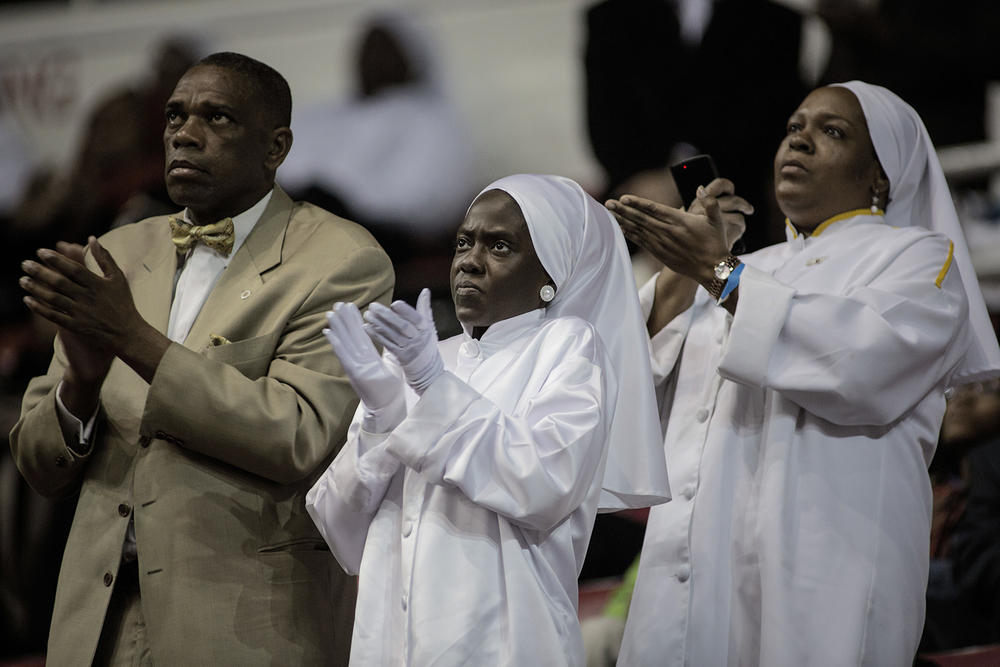 Audience members applaud during the Nation of Islam Saviour's Day Convention on Sunday, Feb. 21, 2016 at Joe Louis Arena in Detroit. Tim Galloway/Special for DFP