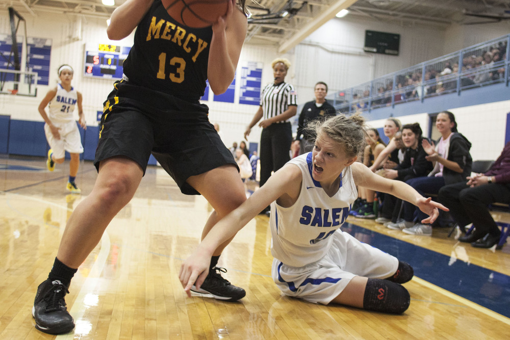 Salem's Jayna Lenders (40/F) loses the ball to Farmington Hills Mercy's Maddy Ballard (13/G) during the Farmington Hills Mercy vs. Salem Girls Basketball game on Friday, Dec. 4, 2015 at Salem High School in Salem. Tim Galloway for DetNews