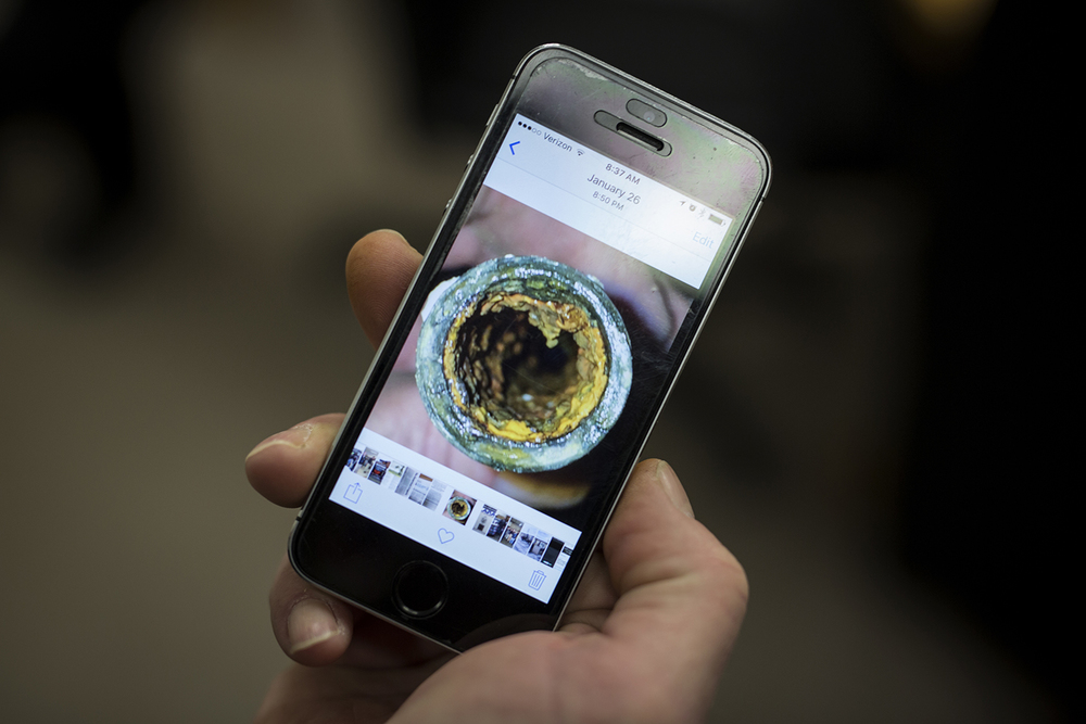 Flint, MI - Feb. 11, 2016: Harold Harrington, business manager at UA Local 370 in Flint, displays a photo on his phone of a pipe in his home filled with sediment potentially connected to the switch of Flint water from the Flint River at UA Local 370 on Thursday, Feb. 11, 2016 in Flint, MI. Tim Galloway for the Wall Street Journal