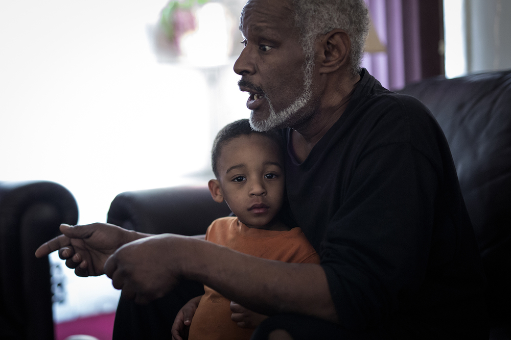 Flint, MI - Feb. 11, 2016: Ja'Son Keith, 2, stands in the arms of his grandfather, Darryl Washington, as he talks about the water crisis in their home on Thursday, Feb. 11, 2016 in Flint, MI. Tim Galloway for the Wall Street Journal