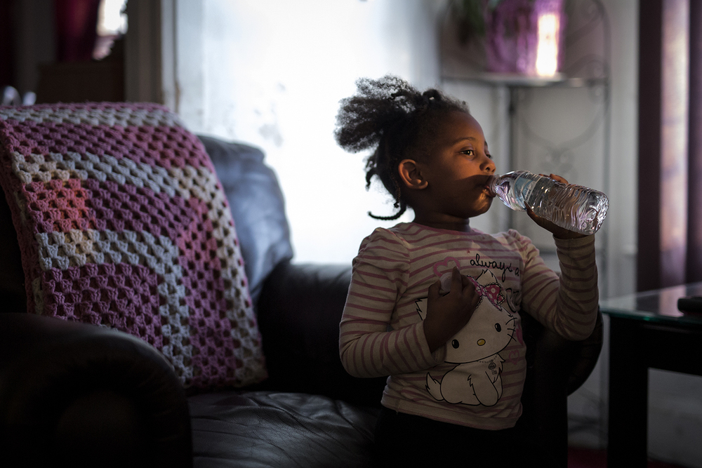 Flint, MI - Feb. 11, 2016: Jayla Keith, 4, drinks from a water bottle in the living room of her home on Thursday, Feb. 11, 2016 in Flint, MI. Tim Galloway for the Wall Street Journal