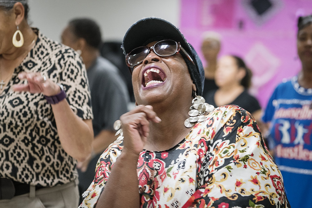 "Flint, MI - Tuesday, October 24, 2017: Flint resident Ethel Brown laughs as she dances with the other Hasselbring Hustlers at the Hasselbring Senior Community Center. Over the past three years, Brown has seen positive results from dancing, including weight loss, better mobility and has witnessed ""people put down their canes.""