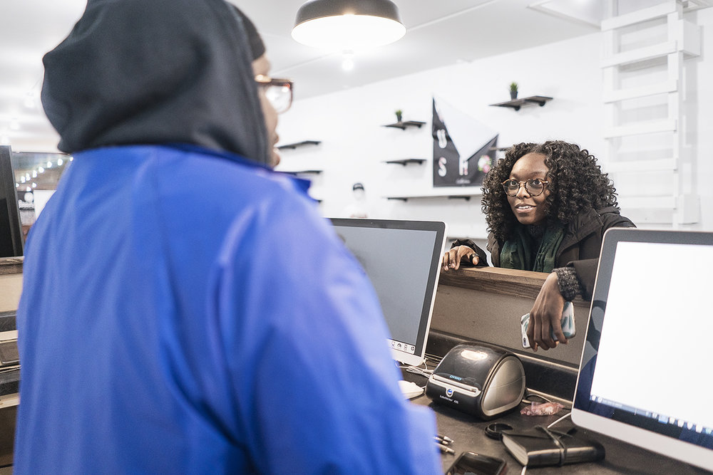Flint, MI - Monday, November 13, 2017: Production manager Andre McGee, 23, of Flint (left), speaks with public relations specialist Lydia Seale, 23, of Flint about the logistics of the upcoming grand opening event on Friday, November 17, 2017.