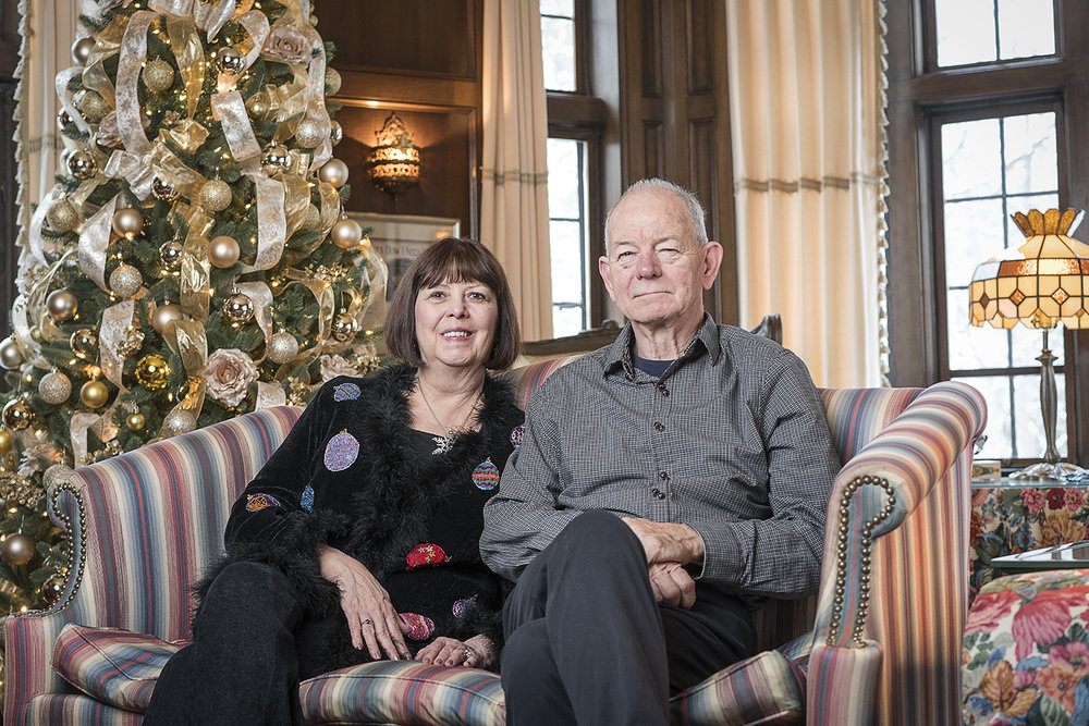 Flint, MI - Saturday, December 9, 2017: Rosanne (left) and Steve Heddy have donated over $300,000 to various charities and college funds over the past twenty years by opening their home for guests to revel in the holiday spirit and view their large Christmas tree collection.