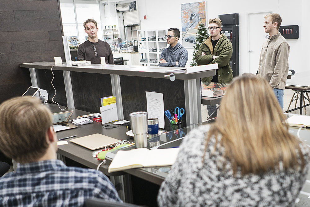 Flint, MI - Friday, December 22, 2017: David Ollila, 47, of Linden, (left) President and Chief Innovation Officer for Skypoint Ventures has a meeting with the staff of 100k Ideas to get the day started.