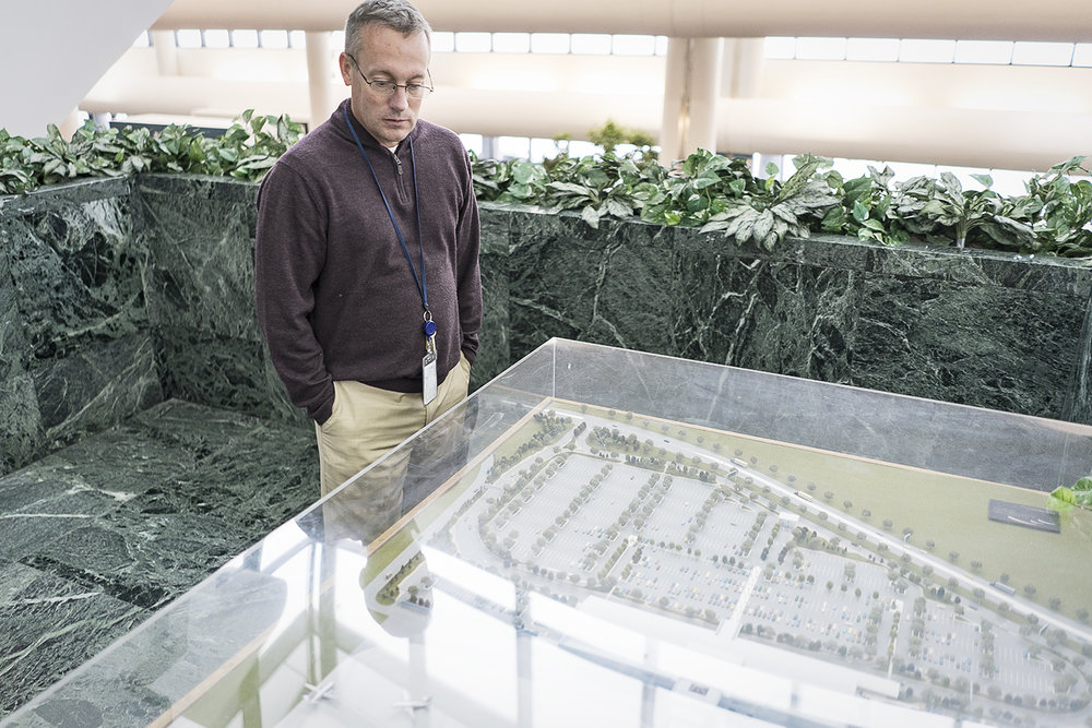 Flint, MI - Wednesday, January 3, 2018: Bishop International Airport Director Craig Williams, 48, of Fenton, looks at the scale model of Bishop as it was envisioned in the early 90's. Remarkably, the airport has very little variation than the original proposed model. 