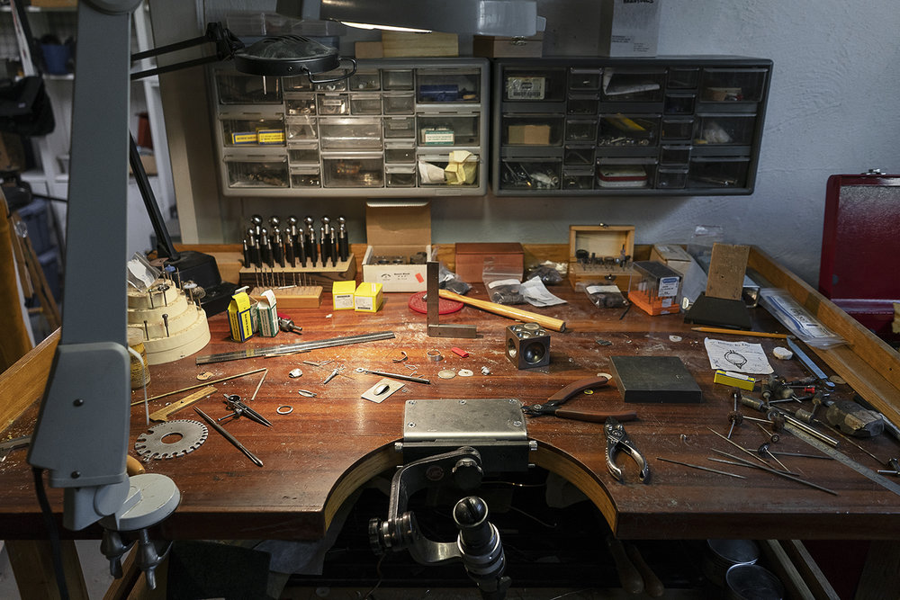 Flint, MI - Tuesday, May 8, 2018: Various pieces of unfinished jewelry and tools rest on a bench in the studio of metalsmith Robert McAdow.