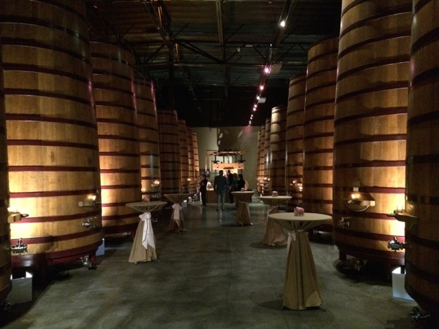 By highlighting points of interest (wine press), leaving cold room elements in the shadows (concrete floor and high ceiling), and using a light color that compliments the barrels (warm white), this industrial space became an intimate cocktail space.