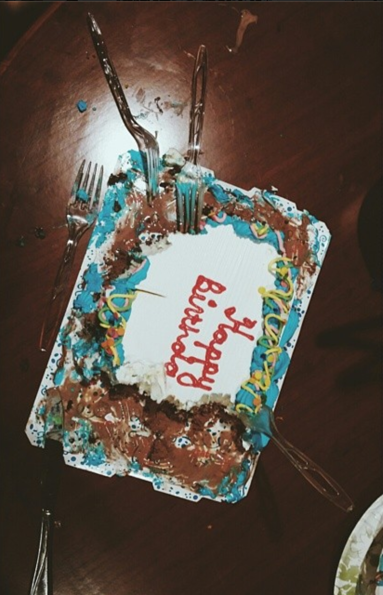 Katherine's birthday cake being shared  (taken via   Rob's instagram  )