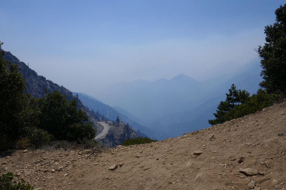 I climb up to a look out point that faces south towards Highway 39. Smoke fills the canyon.