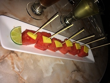 watermelon with mango bites in lime & chile