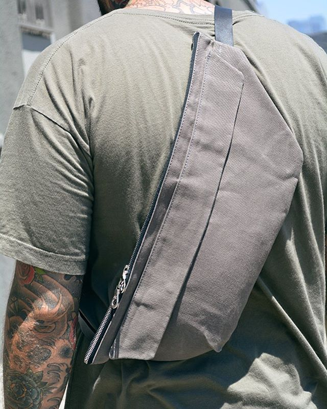 @dominicchambrone Aka @theshoesurgeon with our waxed canvas Sling Pack in slate grey. #lurosa #lurosamfgco #lurosaslingpack #drygoods