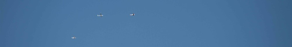 Camera plane, glider and tow-plane are up in the air.