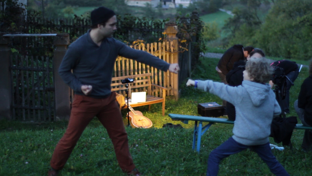 "Aki vs. Egon. There is no mercy during the shoot of ""Kraniche"""