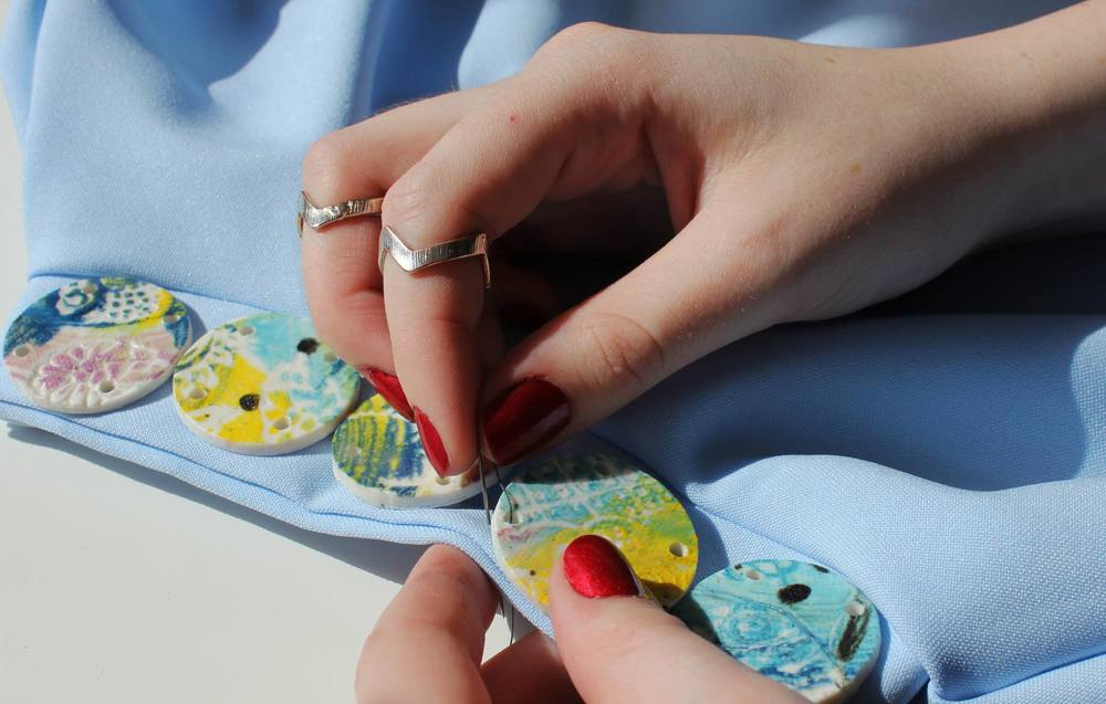 Gayle hand embellishing her latest collection.