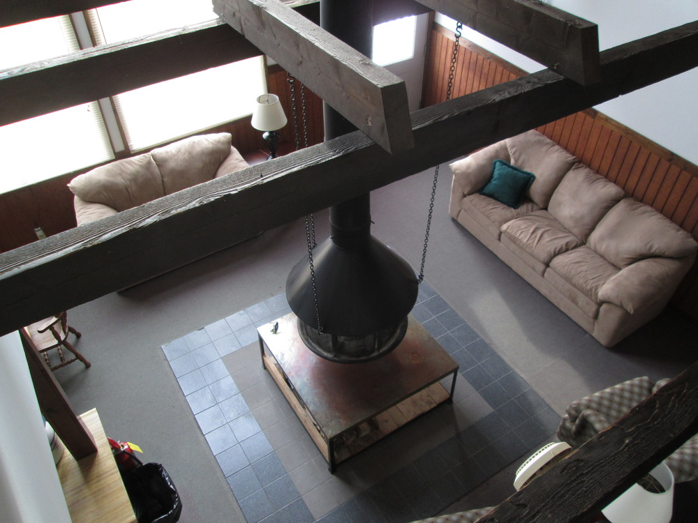 802 Sno Use Looking Down at Hanging Fireplace.JPG